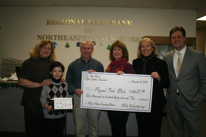 Kathleen Samaniuk-Hayes of the Regional Food Bank; Liam Presser, who collected over $500 for the event; Mark Quandt, Regional Food Bank Executive Director; and NYSMTA event chairs Mary Moran, Noel Liberty and Paul Jennings.
