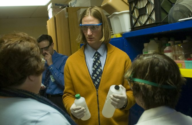 Schalmont High School science teacher Adam Labuda, center, talks to DEC representatives helping conduct a chemical inventory at the school on Tuesday, Dec. 20.
