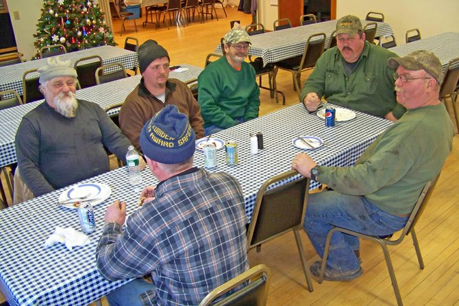 Granted a tribute luncheon Dec. 29 at Thurman Town Hall were highway workers (clockwise, from left rear): Bruce Dingman, Bill Arnold, Ed Brown, Pat Wood, Jeff Ackley, and Tim Arnold.