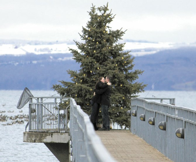Newly engaged couple Mike Avery and Fiona Runwick celebrate with a kiss at the end of the Skaneateles Pier, where the big question was asked and answered.