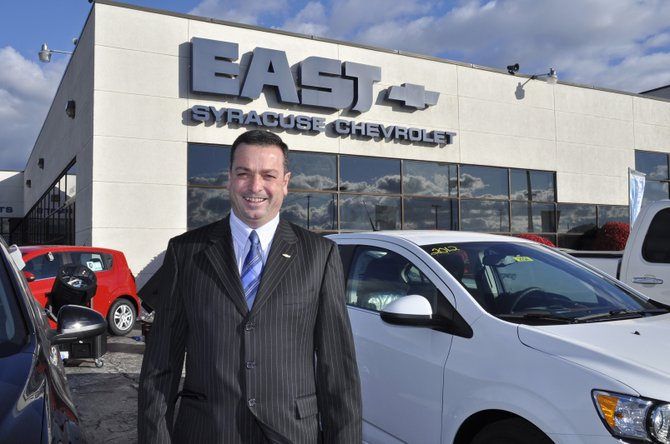 Gino Barbuto stands in front of East Syracuse Chevrolet. He purchased the dealership from Sidney M. Greenberg on Thursday, Dec. 29.