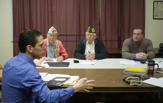 "County Legislator Angelo Santabarbara, far left, talks to members during the Rotterdam AMVETS meeting, from left, ""E J"" Knapik, of Glenville, Carl Petrone, of Duanesburg, and Michael McGrath, of Rotterdam, on Thursday, Dec. 29. The group decided to form a brand new post after debating whether to move Post 21 to Rotterdam."