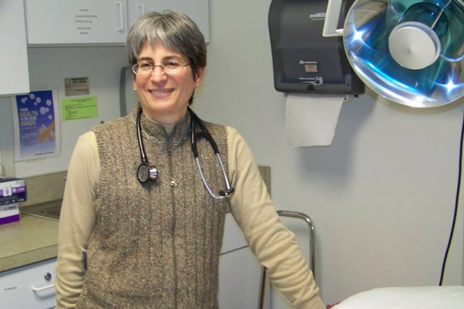 Harriet Busch, a doctor for Hudson Headwaters Health Network, takes a break after seeing a full schedule of patients Wednesday at Chester-Horicon Health Center where she's worked for 31 years. Friday Jan. 6 is her last day at the center, as she is transferring to HHHN's health campus in Queensbury off Aviation Road.