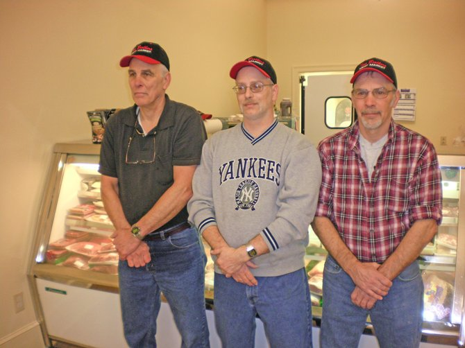 Two Brothers Meat Market owners, from left, Joe, Fred and Gary Namer remain optimistic about the future while their business struggles this winter.