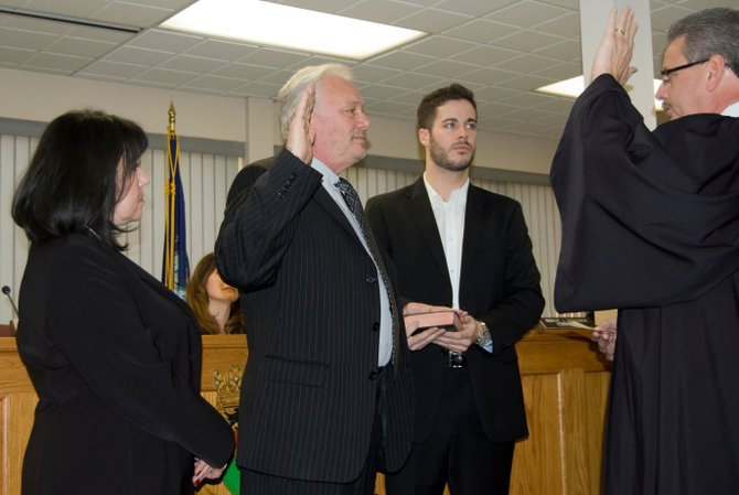 Newly elected Supervisor Harry Buffardi takes the oath of office before the Rotterdam Town Board got down to business.