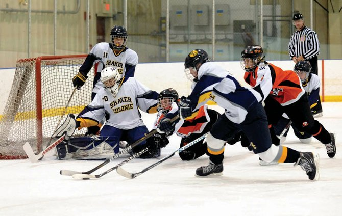Goaltender Kodi Riddell (30) and the Shaker/Colonie defense thwart a Bethlehem scoring bid during Saturday's Capital District High School Hockey League game at the Albany County Hockey Facility.