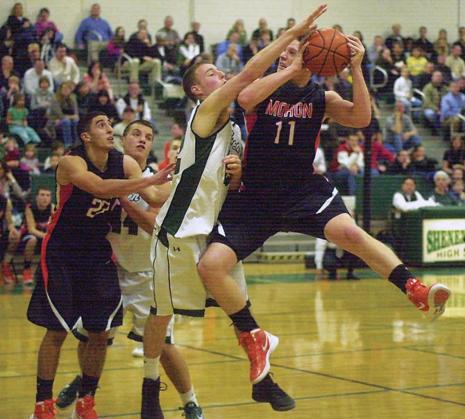 Shenendehowa's Brian Rogers stops Mohonasen's Grant Massaroni's drive during last Friday's Suburban Council game in Clifton Park. The Plainmen ended a two-game losing streak with a 45-43 victory.