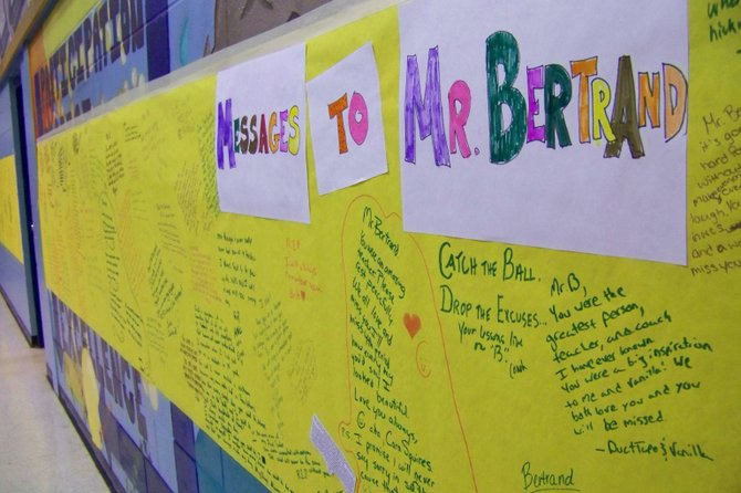 TRIBUTE TO 'MISTER B.': Warrensburg High School Students scrawled hundreds of heartfelt messages to their beloved coach and teacher, the late Brent Bertrand, filling up a 60-fee-long mural that stretched the length of the school cafeteria. Bertrand died early Tuesday of apparent natural causes.