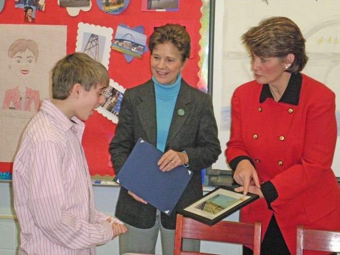 Harrison Rich, a sixth grade student at Moriah Central School, was officially the first person to cross the new Champlain Bridge when it opened Nov. 7. He was honored recently by New York Assemblywoman Teresa Sayward, center, and Vermont House Rep. Diane Lanpher.