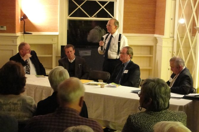 Assemblyman Bill Magee, left, Senator David Valesky and Superintendent Bob Dubik, right, listen to Cazenovia Town Supervisor Ralph Monforte, center, as he speaks to residents during the annual State of the Area Forum, Jan. 10 in Cazenovia.