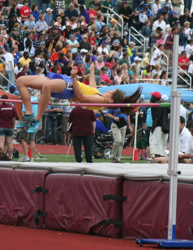 Paige Biviano, shown above competing at last spring's NYS Championship Meet, has set three school records for Cazenovia this season, setting new marks in the high jump, long jump and 55 meter hurdles as she has led the Lakers to wins in their first five invitational meets.