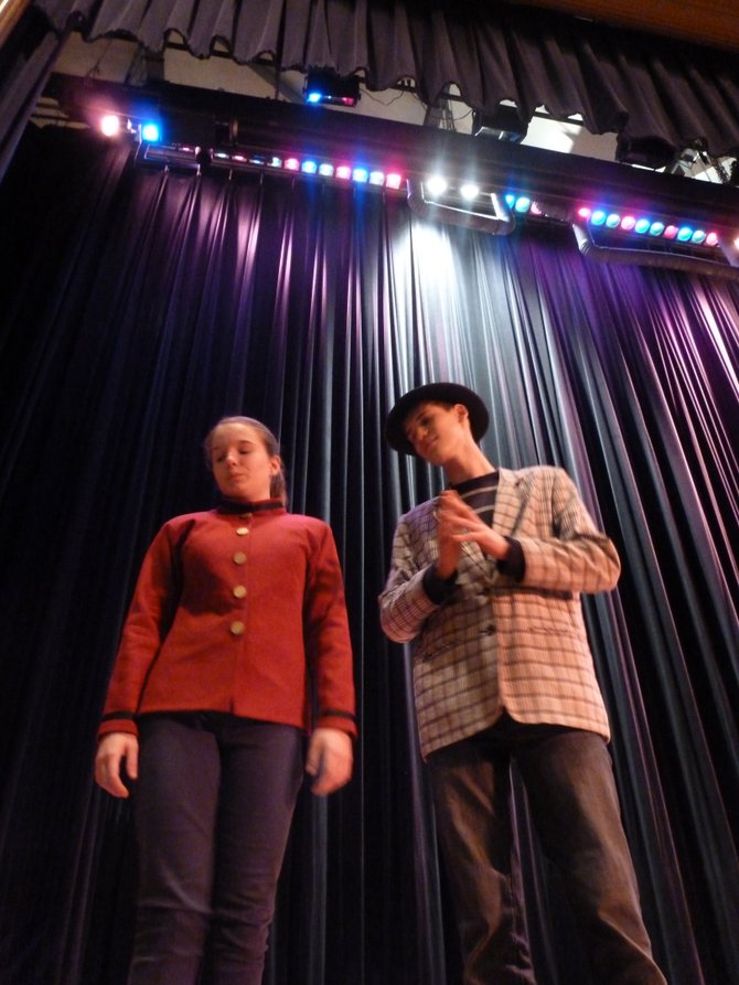 "Sky Masterson (Robert Willard) and Sarah Brown (Hannah Thien) discuss their relationship during the second act of the Bethlehem Middle School play ""Guys and Dolls."""