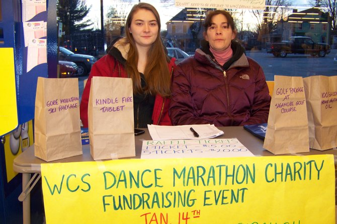 Several days before Warrensburg High School's Marathon Dance held Saturday Jan. 14, student Amber Smith, 18 (left), and her mother Martha Smith sell raffle tickets to raise money in conjunction with the event.