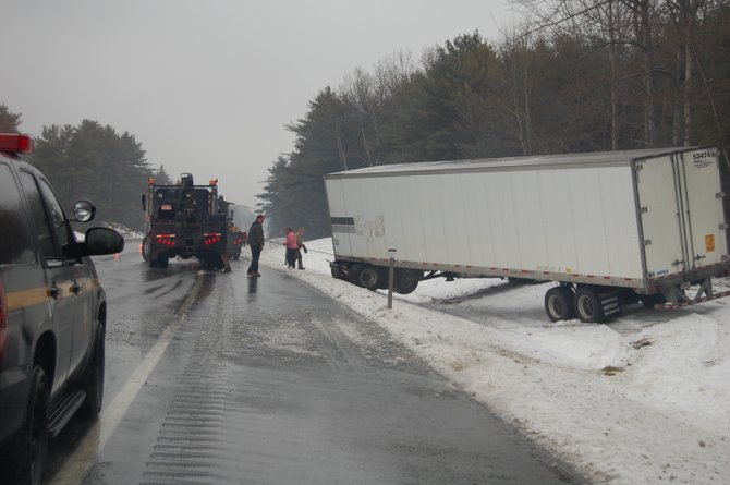 An accident near Exit 32 on the Adirondack Northway involved one tractor trailer truck and automobile.