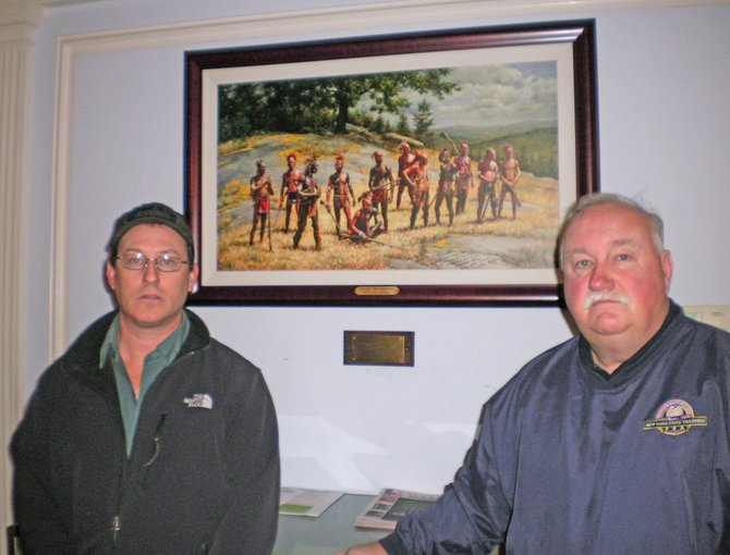 """War Party from Ticonderoga,"" a painting by Robert Griffing, has been donated to the town and now hangs in the Community Building lobby. The donation was arranged by historians Keith Dolbeck, right, and Dan Blanchette of Ticonderoga."
