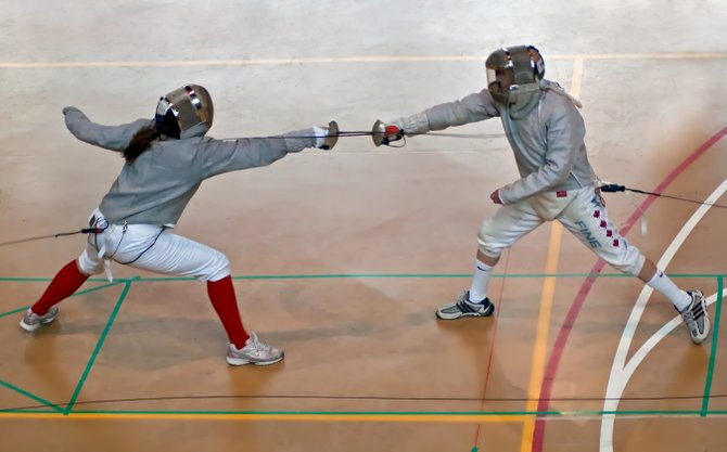 Marvin Fine, right, said he might be shorter than fellow fencers at competitions, but he uses his agility to lead him to victory.