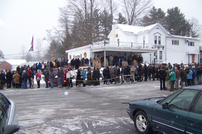 People waited for hours in freezing weather Friday June 13 outside the Alexander-Baker Funeral home in Warrensburg to offer condolences to the family of Brent Bertrand, a beloved teacher and coach, who died Jan. 10 at the age of 53.