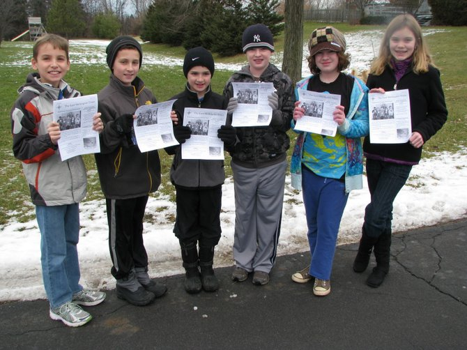 Justin LaBarre, left, Zachary Simms, Aidan Simms, Judd Spaulding, Libby Spaulding and Savannah Johnson deliver the first 40 issues of The East-Wellington Times to residents Saturday, Jan. 7.