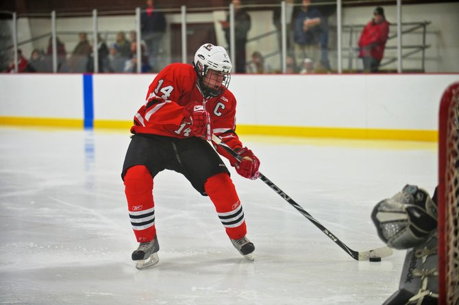 Baldwinsville forward Steve Schneid (14) puts in one of his three goals on a breakaway in last Wednesday's game against Corcoran. Schneid's hat trick helped the Bees beat the Cougars 6-5.