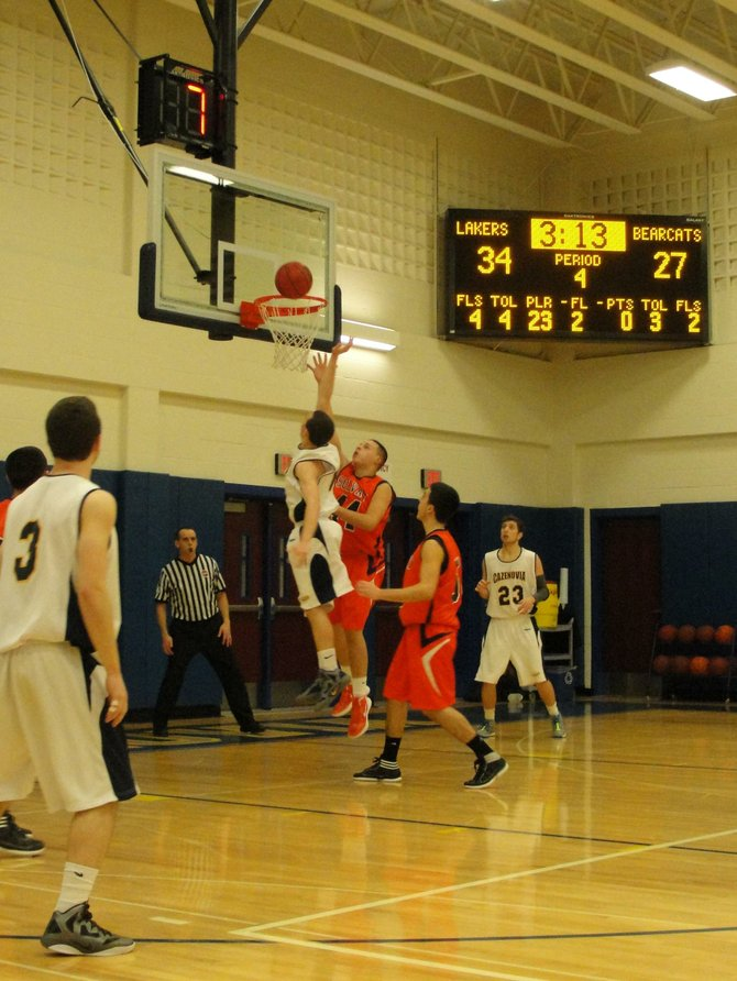 Sophomore guard Kevin Hopsicker scores a layup against the Solvay Bearcats on Jan. 19 in Cazenovia High School's Buckley Gymnasium. After their 38-33 defeat over Solvay, the Laker's season record improved to 10-2.
