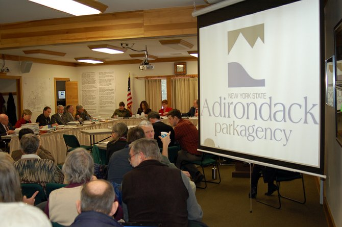 Members of the Adirondack Park Agency Board deliberates on the Adirondack Club and Resort project, proposed for Tupper Lake, during their Jan. 20 meeting.