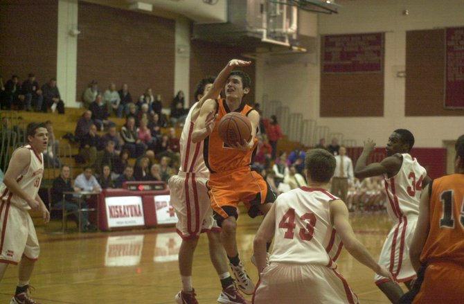 Betlehem's Nate Kane tries a scoop shot under the extended hand of Niskayuna's Chris Giglio during the third quarter of Friday's Suburban Council game.