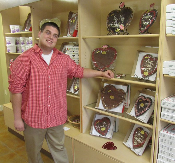 Chocolate Pizza Company owner Ryan Novak shows off some customizable Valentine's Days Pizzas at the renovated shop in Marcellus.