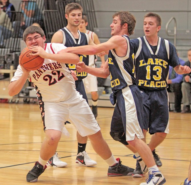 Crown Points Ryan Worth makes an outlet pass during the Panthers 50-40 win against Lake Placid in Mountain and Valley Athletic Conference boys basketball action Jan. 20.