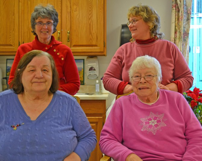 The Adult Day Care program at the Adirondack Tri-County facility could use a few more participants. The program's covered by Medicaid, said Sue Stoddard (top left) who heads the program. Maria Radyn (bottom left) and Beatrice Van Guilder (bottom right) are program participants. Dorothy Baker (top right) works with Stoddard.