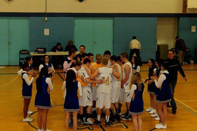 Faith Heritage boys basketball players gather for their prayer prior to a recent game. The Saints upset Tully 50-44 last Friday, avenging a 35-point loss to the Black Knights earlier this season.