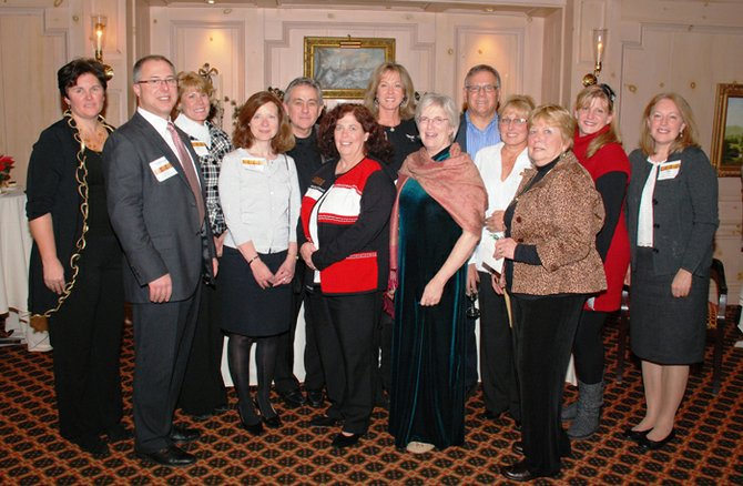 Members of the Skaneateles Area Chamber of Commerce Board of Directors posed for a picture at the chamber's annual Christmas dinner this past December. Included are new members Tom Grant, second from left, and Rita Trenti, far right. Also pictured, from left: Sue Dove, Susan Greenfield-Murphy, Sandi Mulconry, Alain Castel, Anne Bishop, Pam Schoener, Sarah Wiles, Joe Panzarella, Elaine Slater Kogler, Rita Drake and Tracie Barnes.
