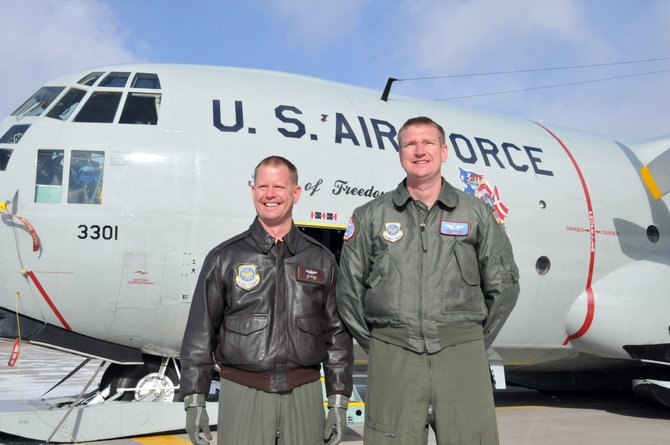 Major Josh Neilson, left, and Tech Sgt. Randy Powell, of the New York Air National Guard's 109th Airlift Wing stand in front of the LC-130 used to evacuate seven badly burned fishermen.