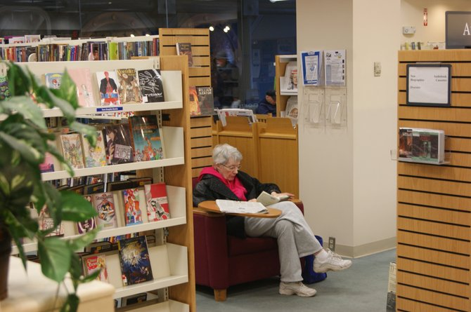 Kathleen Menton frequents the DeWitt Community Library, which is celebrating its 50th birthday this year.