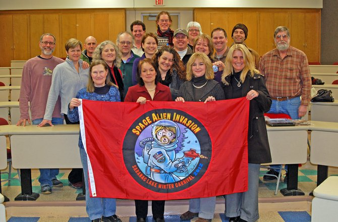 The Saranac Lake Winter Carnival Committee poses for a group photo after their Jan. 25 meeting at the Saranac Lake High School.