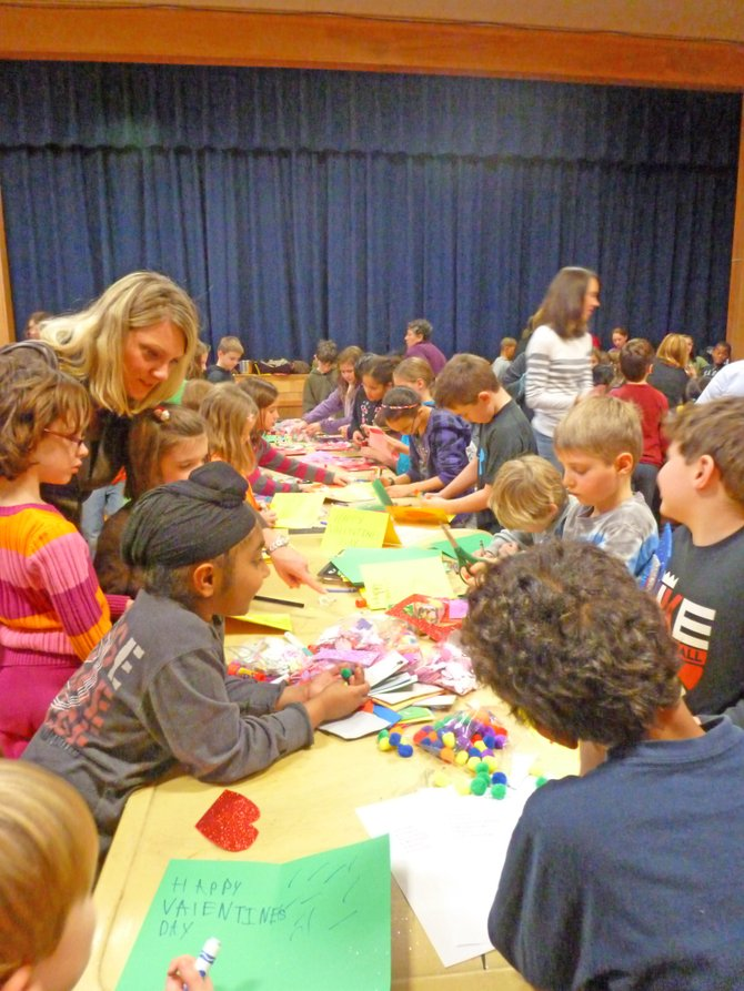 Hamagrael Elementary students take part in an afterschool program where they can volunteer their time to give back to local causes. The day of service is part of the school&#39;s Kids Helping Kids initiative.