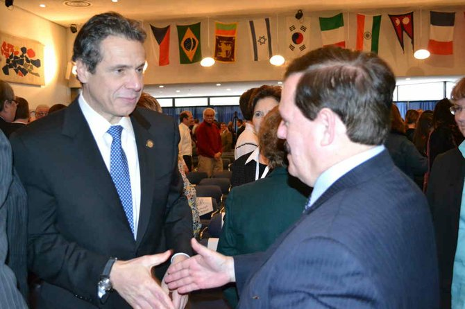 Gov. Andrew Cuomo shakes hands with North Country Chamber of Commerce President Garry Douglas gollowing his budget address at Plattsburgh State University College Feb. 3.
