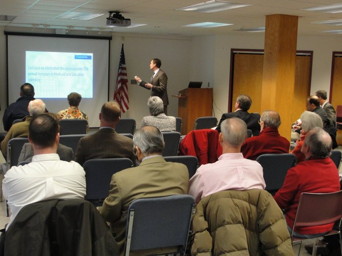 President of the Environmental Facilities Corporation Matt Driscoll presents Governor Andrew Cuomo's proposed 2012-13 state budget to a crowd of more than 20 area residents and local officials, Feb. 3 in the Cazenovia Public Library.