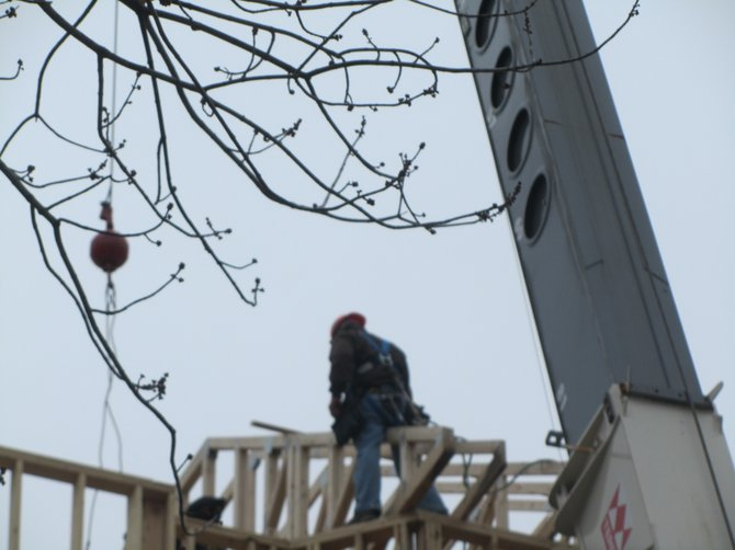 Workers get going on the roof of the new Ronald McDonald Charities of Central New York House on Feb. 3.