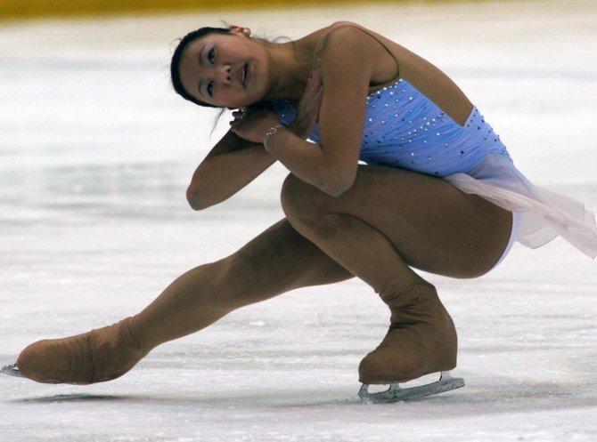 Jennifer Zhang competes in figure skating.