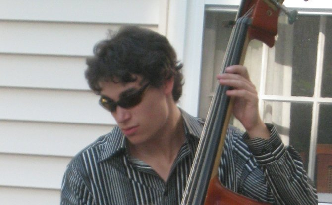 Jacob Bartifeld playing bass at a family friend's wedding.