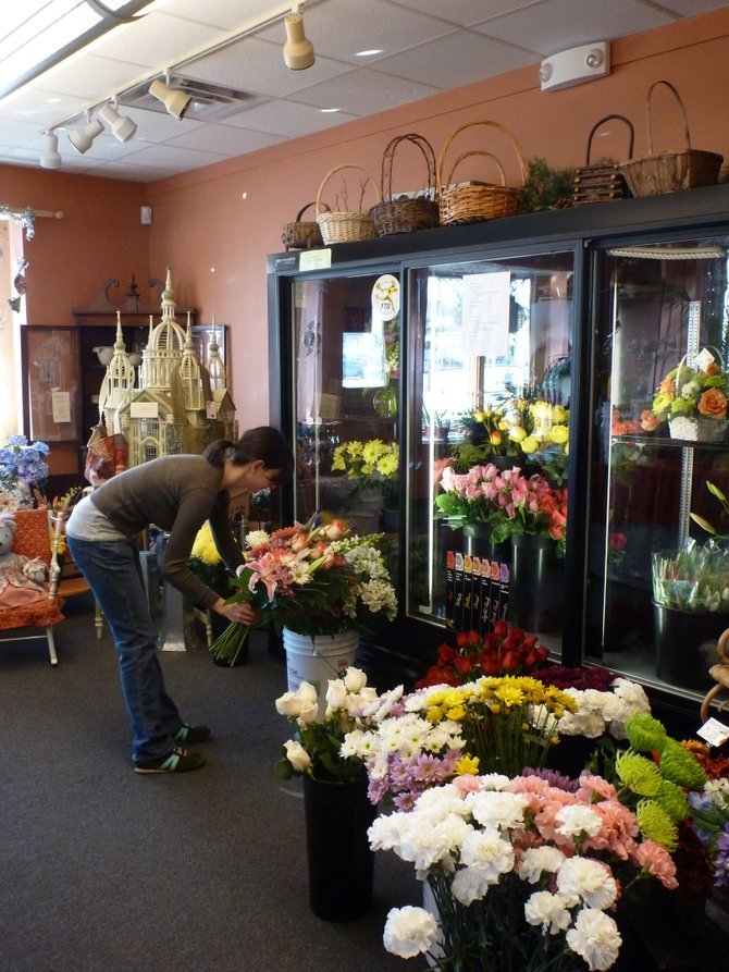 Katie Pietrykowski, floral designer at Delmar Florist in Bethlehem, makes preparations for a busy Valentine's Day.