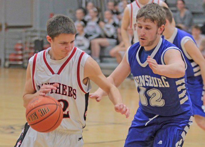 Dan Groshans drives to the hoop in Crown Point's 50-40 win against Johnsburg in Mountain and Valley Athletic Conference boys basketball action Feb. 7.