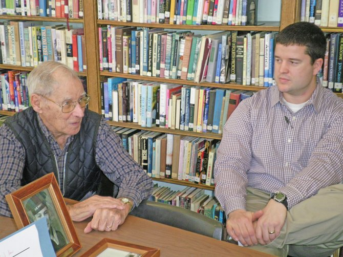 Rolland Yaw, left, of Ticonderoga talks with Ticonderoga High School students about his experiences during World War II. Listening is Bob Sutphen, Ti High social studies teacher.