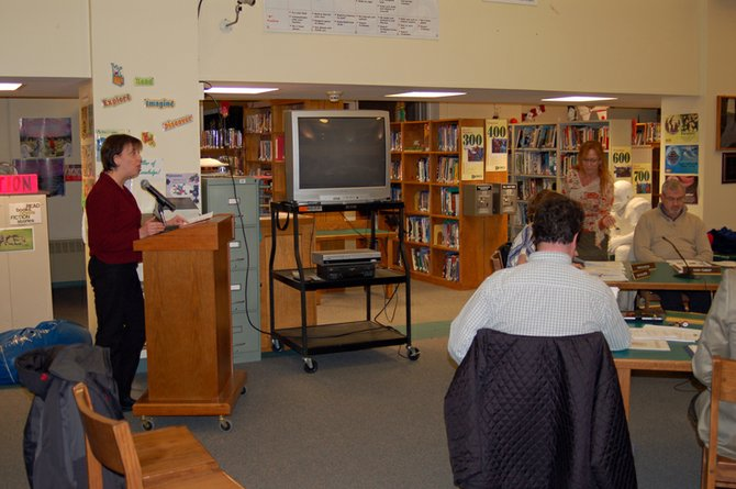 Saranac Lake Middle School counselor Stacy Black helps give a presentation on the Saranac Lake Central School District's suicide prevention protocol to board members during the Feb. 1 meeting.