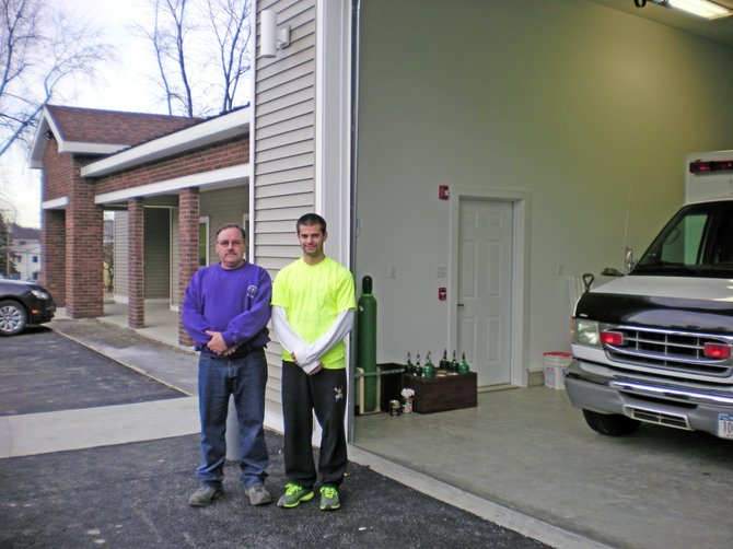 Rick Morse, left, president of the Ticonderoga Emergency Squad, and Mark Barber, captain, stand outside the unit's new building at 118 Champlain Avenue.
