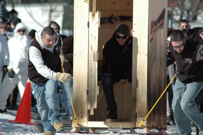 Contestants in the Lake George Winter Carnival&#39;s outhouse race held last weekend drag their creation towards the finish line. This weekend&#39;s carnival action promises a wide range of family activities.