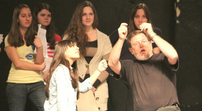 "Mickey Kringer, right, directs and inspires his cast during a recent rehearsal of the upcoming production, ""Phantom of the Opera."" At left is Phoebe Glowacki, who plays the role of Meg Giry."