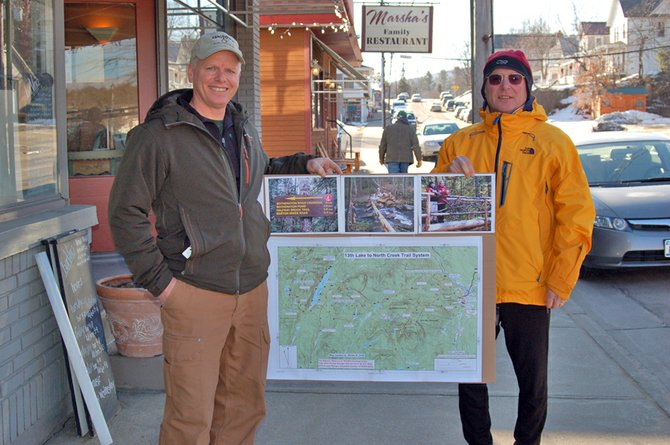 Steven Ovitt and Rick Morse, of the Siamese Ponds Trail Improvement Society, show off the new Thirteenth Lake to North Creek Trail System.