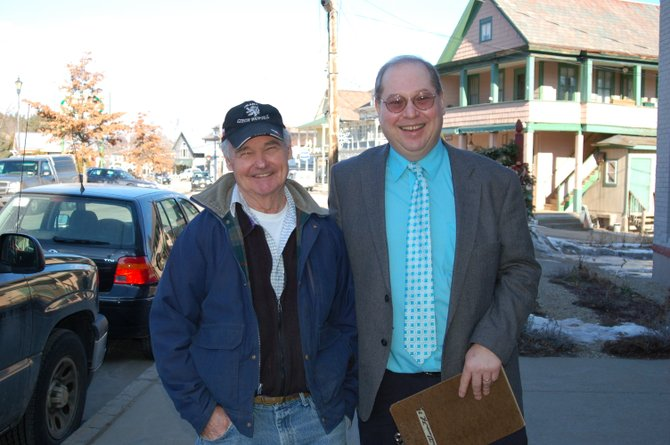 Joel Beaudin, of The Copperfield, and Adirondack Economic Development Corporation Executive Director Jim Murphy walk Main Street in North Creek.