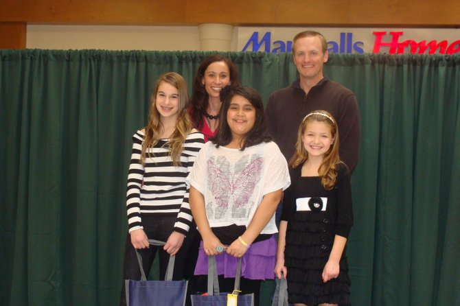 Clifton Park Town Supervisor Phil Barrett presents the Clifton Park Idol winners (ages 6-12) with their prizes. From left to right: 1st place winner Meagan Van Dusen, 11, Idol MC Paula Gretzinger, 3rd place winner Kaylah Brito, 10, Town Supervisor Phil Barrett and 2nd place winner Anne Marie Burke, 10.